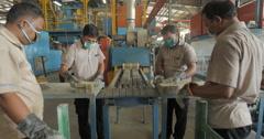 Workers Removing Battery Separators from Industrial Conveyor Belt (4K) Stock Footage