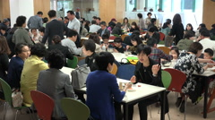 Busy restaurant, people enjoy lunch after Sunday mass in modern Asian church Stock Footage