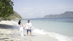 Couple in love on the tropic island - stock footage