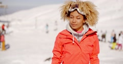 Trendy young woman at an alpine ski resort Stock Footage