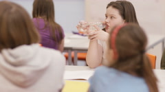 4K Elementary school children in a lesson in classroom - stock footage