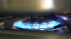 lighting a stove top burner 4k - stock footage