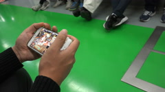 A young man plays a video game in a commuter train in Seoul, South Korea - stock footage