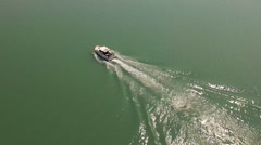 Fishing Boat Cabin Cruiser Heading Out Aerial Stock Footage