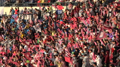 Happy singing baseball fans, pink color, crowds in stadium Seoul, South Korea Stock Footage