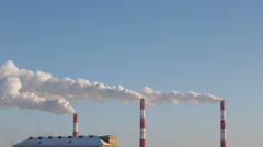 CHP plant steaming in winter sunny day Stock Footage