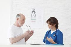 Doctor making vision test for new glasses Stock Photos