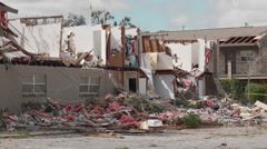 Tornado aftermath - damaged Apartments Stock Footage