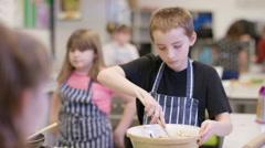 4K Portrait of happy little boy in school cookery class Stock Footage