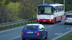 Slowmotion municipal bus goes on road with passengers Stock Footage