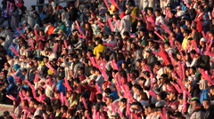 Colorfully dressed baseball supporters support their team in Seoul, South Korea Stock Footage