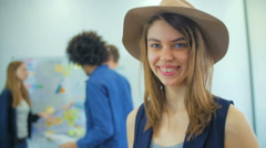 The nice girl in a hat thumbed through news, and then smiles Stock Footage