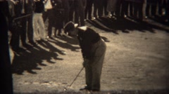 1938: Professional golfer Ralph Guldahl chip shot with crowd surrounded. TRYON, Stock Footage