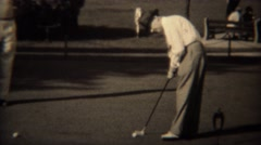1938: Golfers putting on practice green playing close to the hole contest. Stock Footage