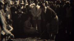 1938: Professional golfer Gene Sarazen hitting shots with crowd surrounded. - stock footage