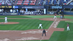 South Korea baseball game, pitcher throws ball, popular sport, match Stock Footage