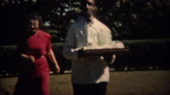 1937: African waiter tray of ice and drinks to rich white drunk patrons. TRYON, - stock footage