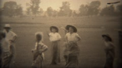 1937: Kids burlap potato sack race in western cowboy hats for fun.  TRYON, NC - stock footage