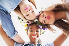 Cute teenage mixed race girls smiling, close - up. Stock Photos