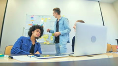 Three young people work over business by the project - stock footage