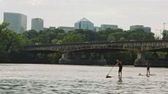 Tracking shot of People kayaking on the Potomac river. Georgetown, Washington DC Stock Footage