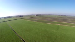 Aerial drone UAV flying low and fast over polder landscape grassland flight 4k Stock Footage
