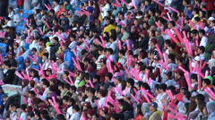 Baseball supporters cheer for their team in South Korea Stock Footage