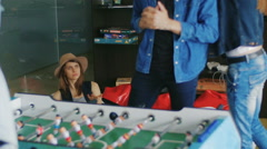 Young people play table football Stock Footage