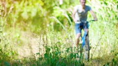 Cyclist Riding a Mountain Bike on a Nature Trail. Video UltraHD Stock Footage