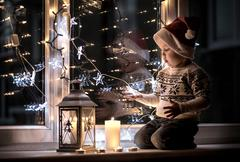 Child in red hat, Christmas eve and New Year - stock photo