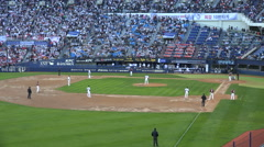 Baseball game in South Korea, view of the pitch and crowd Stock Footage