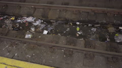 Filthy trash on subway track, garbage in 23rd st train station passengers 4K NYC Stock Footage