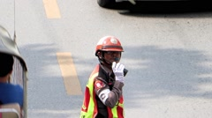 Traffic cop directing traffic on the road Stock Footage