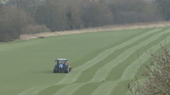 Tractor tows a heavy roller across a field. Stock Footage