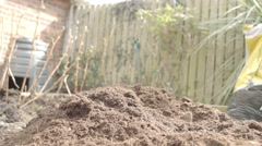 Gardeners Fork cutting through Compost In A Veggie Patch - stock footage