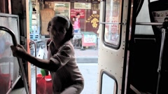 Riding bus opening doors for boarding passengers Arkistovideo