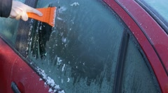 Scraping ice from windshield Stock Footage