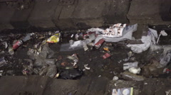 Scanning across dirty trash, garbage on subway tracks in train station, 4K NYC Stock Footage