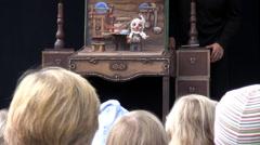Children watching puppet show Stock Footage