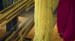 Silk Thread on a Loom in a Cambodian Workshop. Video UltraHD Stock Footage