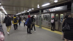 subway at Columbus Circle - train leaving station with high school kids platform - stock footage
