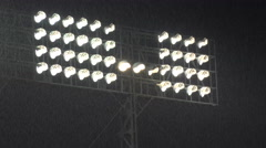 Heavy rain in front of the lights in a baseball sports stadium in South Korea Stock Footage