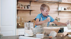 Young child kid baking Stock Footage
