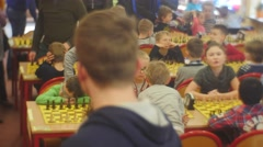 "Parents With Kids on the Chess Tournament Play ""black Knight"" Club People Are Stock Footage"