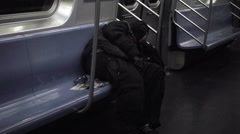 Man sleeping on moving train, homeless guy in New York City Stock Footage