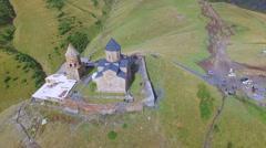 Aerial view of Gergeti Trinity Church Stock Footage