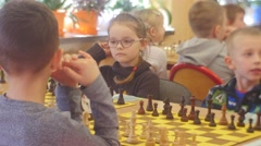 "Bored Boys and Girls on the Chess Tournament ""black Knight"" Club People Are Stock Footage"