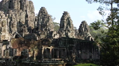 Pan past Bayon Camboia ruins Stock Footage
