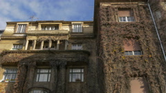 Beautiful view of an old building filled with dried climbing plants in Zagreb Stock Footage