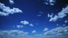 Saturated blue sky cloud scape - stock footage